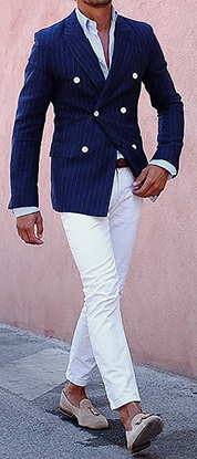 Picture of Double-breasted navy jacket with cream trousers